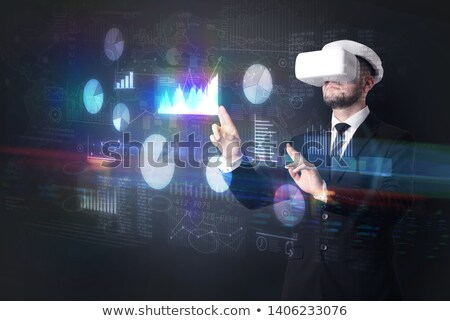 Man wearing VR goggles with charts and reports Stock fotó © ra2studio