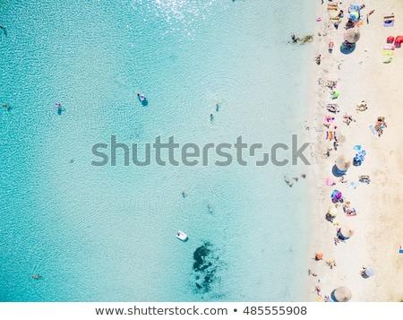 Luchtfoto zandstrand zwemmen mensen kleurrijk parasols Stockfoto © denbelitsky