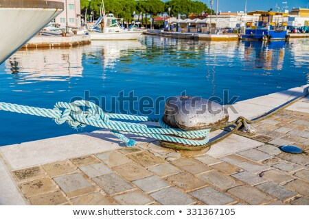 Stainless steel bollard with a rope Stock photo © andreasberheide