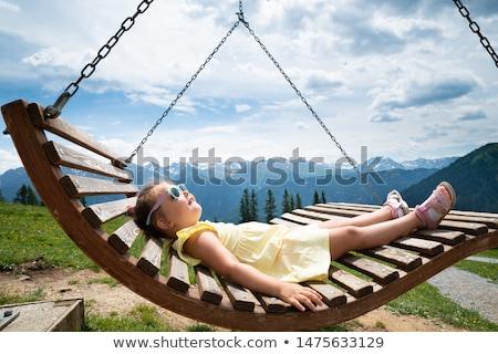 девочку расслабляющая Swing кровать гор Сток-фото © AndreyPopov