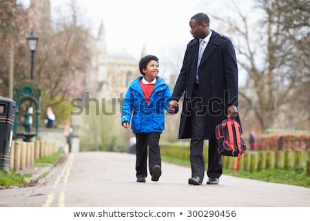 Father and son go on the park path. Stock photo © galitskaya