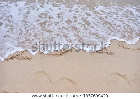 2020 Year Written On Sand Near The Sea At Beach Stock photo © AndreyPopov