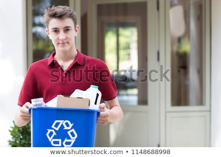 teenager boy with recycle bin outside Stock photo © Lopolo
