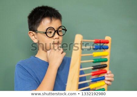 Nadenkend asian jongen leren Stockfoto © wavebreak_media