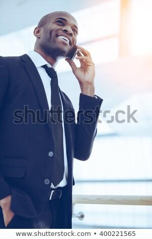 Ver feliz jovem empresário falante Foto stock © wavebreak_media