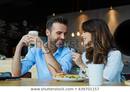 Man and Woman, Couple Eating Food in Cafeteria Stock photo © robuart
