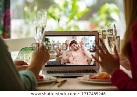 Man and woman are sitting in quarantine, sitting at home and watching TV. Coronavirus, epidemic, qua Stock photo © galitskaya