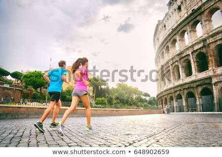 Runners running next to colosseum in Rome city, Italy, Europe travel destination. Healthy active peo Stock photo © Maridav