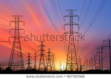silhouette of power lines and electric pylons stock photo © glyph
