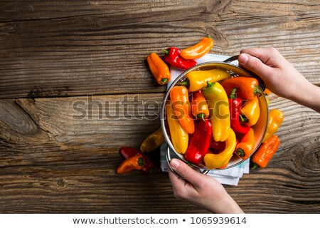 Large red bell pepper in  hand Stock photo © ozaiachin