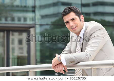 Business on break stood outside office building Stock photo © photography33