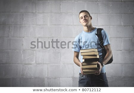 High School boy carrying bag and books Stock photo © lovleah