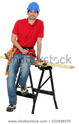 A carpenter seating on a workwrench. Stock photo © photography33