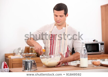 Man stirring mixture in bowl Stock photo © photography33