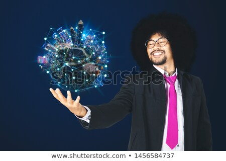 Concept shot of a businessman holding a miniature globe Stock photo © photography33
