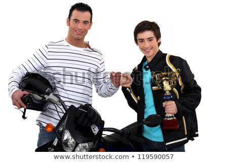 Father congratulating son on motocross victory Stock photo © photography33