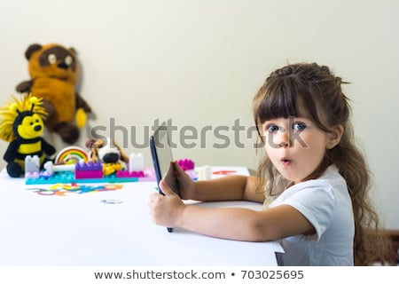young girl with tablet pc stock photo © maisicon