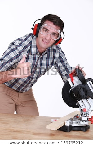 Laborer with miter saw Stock photo © photography33