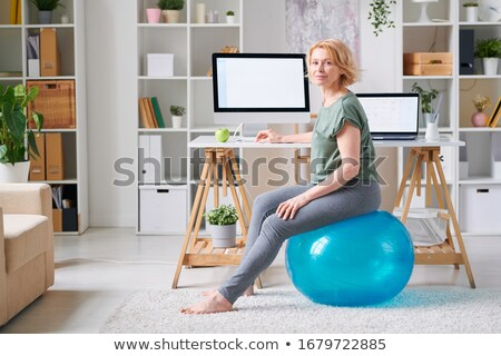Young ethnic woman working out with a pilates ball stock photo © wavebreak_media