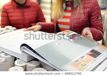 man holding selection of wallpaper stock photo © photography33