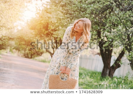 pretty blonde woman with the purse stock photo © acidgrey
