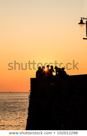 Group of People Watching Sunset in Riomaggiore, Italy Stock photo © anshar