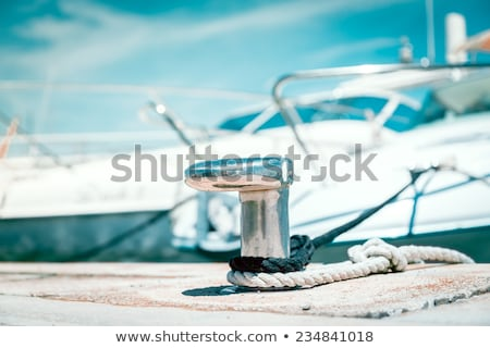 Stock photo: Boat bollard, ropes and knots in mediterranean harbor