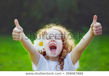 Aranyos fiatal nő hüvelykujj felfelé kézmozdulat portré Stock fotó © williv