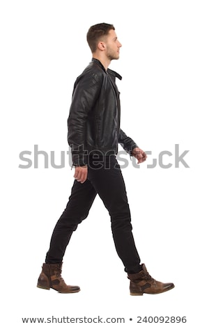 side view of a casual man in jeans and jacket stock photo © feedough