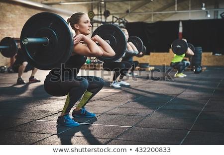 athletic woman lifting weights stock photo © iko