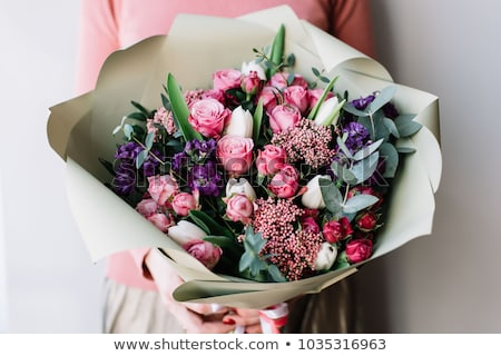 Young Woman Holding Purple Flowers Stock photo © AndreyPopov
