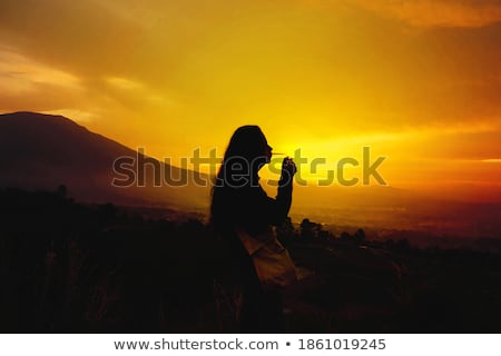 young man lights cigarette in mountains Stock photo © feedough