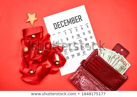 Calendar paper ball and dollar Stock photo © devon