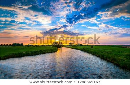 закат реке небе воды облака трава Сток-фото © Kayco