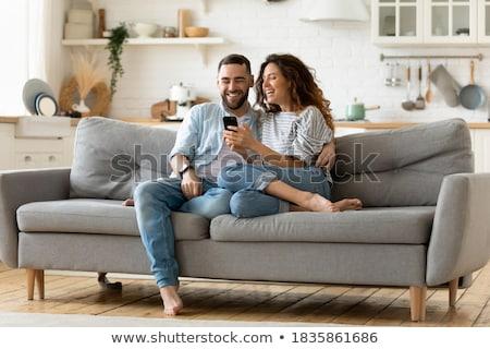 encantado · homem · falante · telefone · usando · laptop · cozinha - foto stock © monkey_business