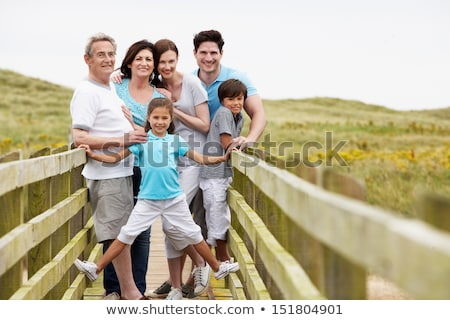 family walking along wooden bridge stock photo © monkey_business