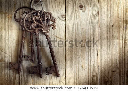 big old key on the wooden table stock photo © kayco