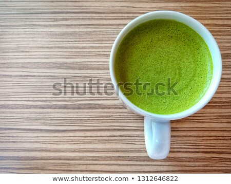 close up hot matcha green tea latte on wood table stock photo © nalinratphi