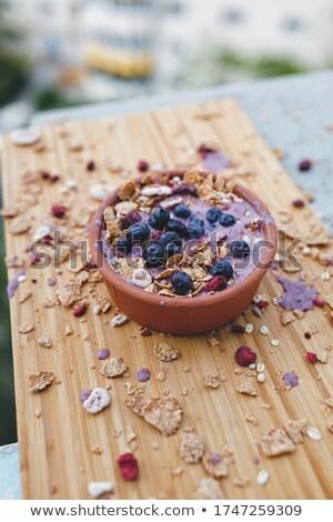 Ontbijtgranen vers frambozen bosbessen yoghurt schotel Stockfoto © raphotos
