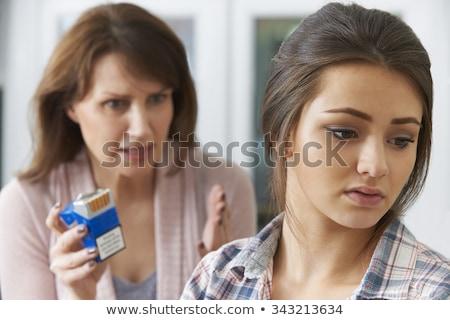 Mother Confronting Daughter Over Dangers Of Smoking Stock photo © HighwayStarz