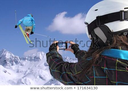 Skok młoda dziewczyna telefonu komórkowego kobieta niebo Zdjęcia stock © smuki