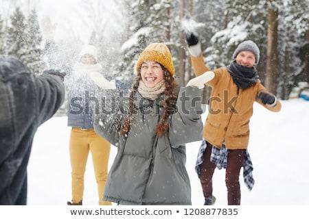 Lány hógolyó gyerekek hó tél játék Stock fotó © adrenalina