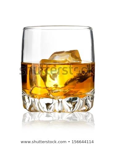 Bir cam viski rom yeşil arka ışık Stok fotoğraf © Klinker