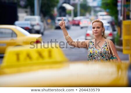 Işkadını taksi bavul gülen Stok fotoğraf © Flareimage