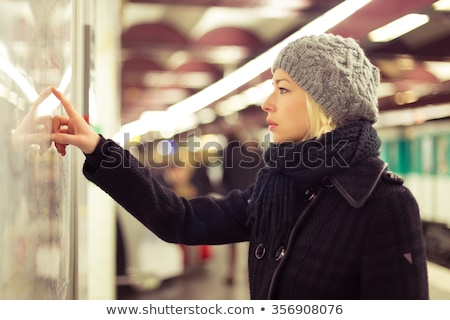 Lady looking on public transport map panel. Stock photo © kasto