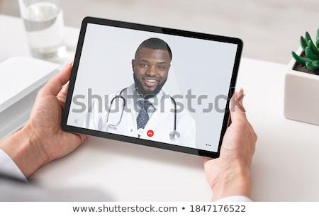 женщины врач цифровой таблетка работу больницу Сток-фото © Klinker
