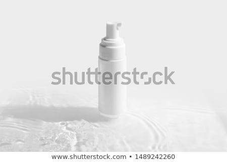 Elegant bottle of foam bath stock photo © Luisapuccini