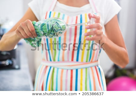 Young woman polishing a glass in her modern kitchen Stock photo © lightpoet