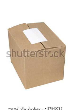 Boîte en carton d'expédition fermée avec étiquette vide blanche Photo stock © caimacanul