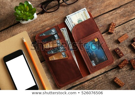 leather notebook and pencil with wallet stock photo © ozaiachin